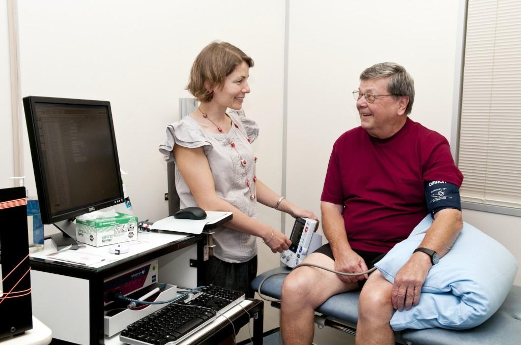 Dr Jasmine Menant measures a patient's blood pressure