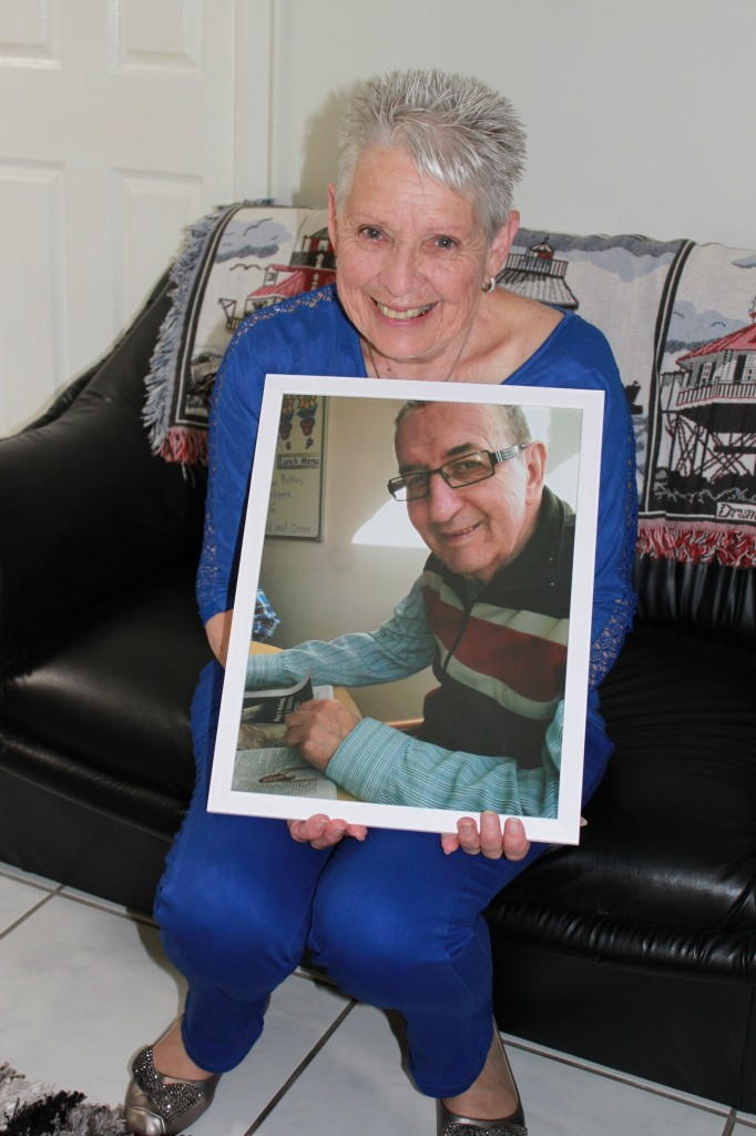 Wendy Smith, holding a picture of her husband George