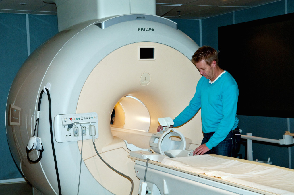 Dr Michael Green with the MRI scanner.